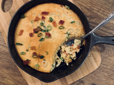 Mac and Cheese topped with cornbread made with organic eggs, baked in a cast iron skillet