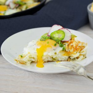 slice of hash brown skillet casserole with runny egg